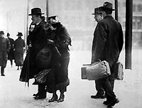 Dr. Ernst Kunwald, former conductor of the Cincinnati Symphony Orchestra, entering the Federal Building, Cincinnati, Ohio, as a prisoner of war in charge of two U.S. deputy marshals.  1917.  J. R. Schmidt. (War Dept.)<br /> EXACT DATE SHOT UNKNOWN<br /> NARA FILE #:  165-WW-157A-1<br /> WAR & CONFLICT BOOK #:  689