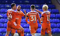 Blackpool's Gary Madine, left, celebrates scoring the opening goal with team-mates, from left, CJ Hamilton, Ben Woodburn and Kenny Dougall<br /> <br /> Photographer Chris Vaughan/CameraSport<br /> <br /> The EFL Sky Bet League One - Peterborough United v Blackpool - Saturday 21st November 2020 - London Road Stadium - Peterborough<br /> <br /> World Copyright © 2020 CameraSport. All rights reserved. 43 Linden Ave. Countesthorpe. Leicester. England. LE8 5PG - Tel: +44 (0) 116 277 4147 - admin@camerasport.com - www.camerasport.com