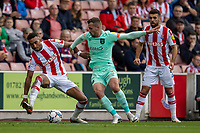11th September 2021;  Bet365 Stadium, Stoke, Staffordshire, England; EFL Championship football, Stoke City versus Huddersfield Town; Jacob Brown of Stoke City under pressure from  Harry Toffolo of Huddersfield Town