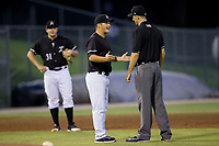 Kannapolis Intimidators manager Justin Jirschele (9) argues a call with base umpire John Benken during the game against the Hagerstown Suns at Kannapolis Intimidators Stadium on July 10, 2017 in Kannapolis, North Carolina.  The Suns defeated the Intimidators 8-5.  (Brian Westerholt/Four Seam Images)
