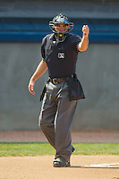 Home plate umpire Ben Leake makes a strike call during an Appalachian League game between the Bluefield Orioles and the Princeton Rays at Hunnicutt Field July 4, 2010, in Princeton, West Virginia.  Photo by Brian Westerholt / Four Seam Images