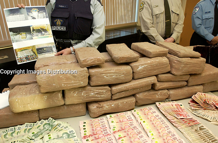 December 04,  2002, Montreal, Quebec, Canada; <br /> <br /> ) Policemen show drug, guns and money<br /> seized during a recent drug bust,to the medias,<br />  December 04, 2002 in Montreal, Canada.<br /> <br /> 15 people presumably involveld in a 2 billion Can $ drug deal, where arrested after a joint operation by the RCMP, Quebec Province and Montreal City Police.<br /> <br /> <br /> <br /> (Mandatory Credit: Photo by Sevy - Images Distribution (©) Copyright 2002 by Sevy<br /> <br /> NOTE :  D-1 H original JPEG, saved as Adobe 1998 RGB.<br />  Uncompressed and uncropped original  size file available on request.