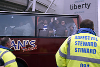 ATTENTION SPORTS PICTURE DESK<br /> Pictured: Cardiff supporters arriving in coaches guarded by heavy police presence.<br /> Re: Coca Cola Championship, Swansea City Football Club v Cardiff City FC at the Liberty Stadium, Swansea, south Wales. Saturday 07 November 2009