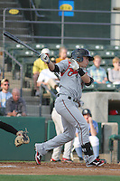 Carolina Mudcats shortstop Tony Wolters #11 at bat during the first game of a doubleheader against the Myrtle Beach Pelicans at Tickerreturn.com Field at Pelicans Ballpark on May 10, 2012 in Myrtle Beach, South Carolina. Myrtle Beach defeated Carolina by the score of 2-1. (Robert Gurganus/Four Seam Images)