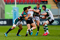 28th March 2021; Mattoli Woods Welford Road Stadium, Leicester, Midlands, England; Premiership Rugby, Leicester Tigers versus Newcastle Falcons; Ben Stevenson of Newcastle Falcons is tackled by Matias Moroni and George Ford of Leicester Tigers