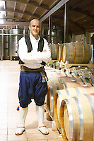 One of the waiters from the restaurant in the winery dressed in local traditional clothes Hercegovina Produkt winery, Citluk, near Mostar. Federation Bosne i Hercegovine. Bosnia Herzegovina, Europe.