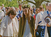 """May Queen of Ickwell, Katie Bryant.<br /> <br /> """"A rosy crown we twine for thee, of floraís richest treasure. We lead thee forth to dance and sing, to mirth and youthful pleasure. Take, o take, the rosy, rosy crown. Take, take the rosy, the rosy crown."""""""