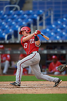 Washington Nationals catcher Alex Dunlap (27) follows through on a swing during a Florida Instructional League game against the Miami Marlins on September 26, 2018 at the Marlins Park in Miami, Florida.  (Mike Janes/Four Seam Images)