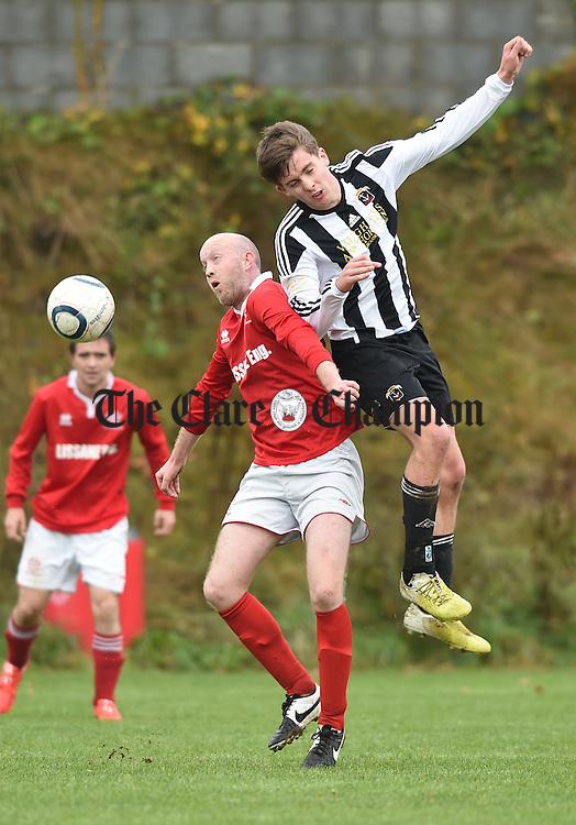 Damien Mc Auley of Newmarket B in action against Kevin Falvey of Moher Celtic during their game in Newmarket. Photograph by John Kelly.