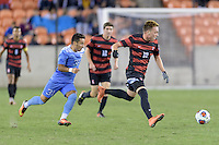 Houston, TX -  Friday, December 9, 2016: Corey Baird (10) of the Stanford Cardinal races for the goal with Nico Melo (31) of the North Carolina Tar Heels in pursuit at the  NCAA Men's Soccer Semifinals at BBVA Compass Stadium.