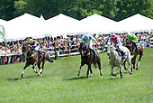 The race is on! Scuba Steve, left, Justpourit, center, and Won Wild Bird are all out to the wire in the Radnor Hunt Cup.