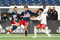 FOXBOROUGH, MA - OCTOBER 16: Justin Rennicks #12 of New England Revolution II fends off Justin Che #46 of North Texas SC during a game between North Texas SC and New England Revolution II at Gillette Stadium on October 16, 2020 in Foxborough, Massachusetts.