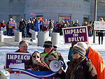 Augusta, Maine, USA, 6 Jan 2016, Advocates of impeachment of Gov. LePage in front of a group of the governor's supporters, ©Kevin Shields/Alamy Live News