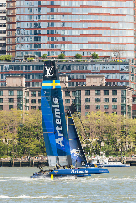 The Artemis Team Sweden catamaran races on the Hudson River near Brookfield Place in the America's Cup World Series.