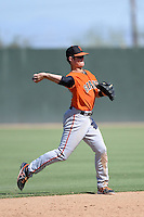 San Francisco Giants shortstop Christian Arroyo (22) throws to first during an instructional league game against the Oakland Athletics on September 27, 2013 at Papago Park Baseball Complex in Phoenix, Arizona.  (Mike Janes/Four Seam Images)