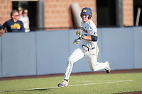 Michigan Wolverines outfielder Miles Lewis (3) sprints past third base headed home against the Central Michigan Chippewas on May 9, 2017 at Ray Fisher Stadium in Ann Arbor, Michigan. Michigan defeated Central Michigan 4-2. (Andrew Woolley/Four Seam Images)
