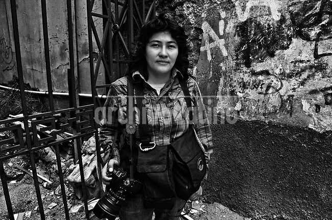 """Wara Vargas Lar, the """"mom"""" of the group.They are all between their  20's and 30's. They like to call themselves Kamikazes, and they are the new generation of street photo journalists of Bolivia. In a country where photographers are extremely poorly paid, no one can image that this army of young guys and girls are always ready to risk their lives running behind they care most: a good picture telling a news.<br /> Thought the new eyes of this young generation, our photographer and friend in La Paz, French born Cristian Lombardi shows the impacting reality of this South American mostly indigenous nation. In a patient work, Lombardi edited thousands of frames to show as a glimpse of what these new young eyes are watching."""