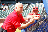 Hall of Fame shortstop Cal Ripken Jr. talks with Larry Bowa who coaches the National team during the Under Armour All-American Game at Wrigley Field on August 13, 2011 in Chicago, Illinois.  (Mike Janes/Four Seam Images)