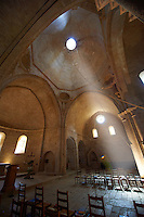 Interior of the 12th century Romanesque Cistercian Abbey of Notre Dame of Senanque ( 1148 ) set amongst the flowering lavender fields of Provence near Gordes, France.