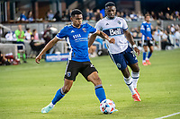 SAN JOSE, CA - AUGUST 13: Marcos Lopez #27 of the San Jose Earthquakes dribbles the ball during a game between San Jose Earthquakes and Vancouver Whitecaps at PayPal Park on August 13, 2021 in San Jose, California.