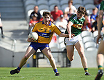 Cillian Rouine of Clare in action against Colm Moriarty of Kerry during their Munster Minor football final at Pairc Ui Chaoimh. Photograph by John Kelly.