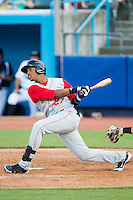 Michael Bernal (27) follows through on his swing against the Hudson Valley Renegades at Dutchess Stadium on June 18, 2014 in Wappingers Falls, New York.  The Cyclones defeated the Renegades 4-3 in 10 innings.  (Brian Westerholt/Four Seam Images)