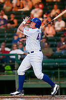 First Baseman Justin Bour #41of the Daytona Beach Cubs watches his homerun against the Brevard County Manatees at Jackie Robinson Ballpark on April 9, 2011 in Daytona Beach, Florida. Photo by Scott Jontes / Four Seam Images
