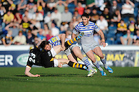 Marcelo Bosch of Saracens brings down Charlie Hayter of London Wasps during the Aviva Premiership match between London Wasps and Saracens at Adams Park on Saturday 29th March 2014 (Photo by Rob Munro)
