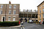 The concrete of the East Stand at St James Park contrasting with the adjacent victorian and Goergian style houses. Newcastle v West Ham, August 15th 2021. The first game of the season, and the first time fans were allowed into St James Park since the Coronavirus pandemic. 50,673 people watched West Ham come from behind twice to secure a 2-4 win.