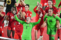 YOKOHAMA, JAPAN - AUGUST 6: Canada players including Stephanie Labbe #1 celebrate winning in the gold medal match during a game between Canada and Sweden at International Stadium Yokohama on August 6, 2021 in Yokohama, Japan.