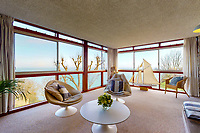 BNPS.co.uk (01202) 558833. <br /> Pic: Albury&Hall/BNPS<br /> <br /> Pictured: Living room. <br /> <br /> A unique 'grand design' cliff-top home that has dramatic sea views has gone on the market for £2m.<br /> <br /> The three storey six-bedroom property was designed in the 1960s by architect John Morgan for him to live in.<br /> <br /> At the time the flat-roofed building with floor to ceiling windows was considered a revolutionary design.<br /> <br /> The property's stunning location on the cliffs above Swanage in Dorset provide uninterrupted sea views of Poole Bay and across to The Needles on the Isle of Wight.