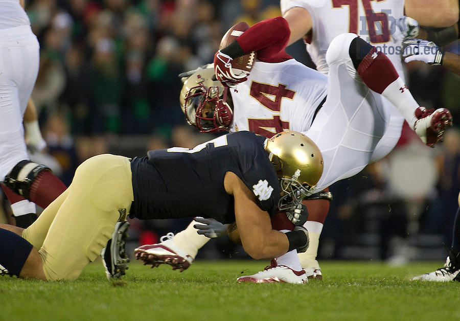 November 19, 2011; Notre Dame Fighting Irish inside linebacker Manti Te'o (5) tackles Boston College Eagles running back Andre Williams during the first quarter. Photo by Barbara Johnston/University of Notre Dame.
