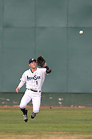 Braden Bishop (9) of the Everett AquaSox makes a diving catch during a game against the Spokane Indians at Everett Memorial Stadium on July 24, 2015 in Everett, Washington. Everett defeated Spokane, 8-6. (Larry Goren/Four Seam Images)