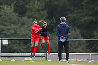 (Left to right)  Sheila Broos of Woluwe (20) and Stephanie Suenens of Woluwe (17) pictured during the warm up before a female soccer game between Oud Heverlee Leuven and Femina White Star Woluwe  on the 5 th matchday of the 2020 - 2021 season of Belgian Womens Super League , Sunday 18 th of October 2020  in Heverlee , Belgium . PHOTO SPORTPIX.BE | SPP | SEVIL OKTEM