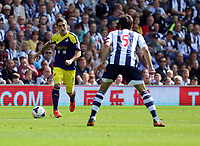 Pictured L-R: Pablo Hernandez of Swansea against Claudio Yacob of West Brom. Sunday 01 September 2013<br /> Re: Barclay's Premier League, West Bromwich Albion v Swansea City FC at The Hawthorns, Birmingham, UK.