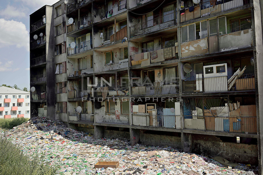 Lunik IX is now home to five thousand Roma, since 2011 the local government have demolished five blocks subsequently living Roma inhabitant now where to live. As the local government don't send binmen to Lunik IX, the inhabitants have no choose but to dump their waste below.