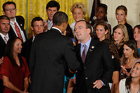 Sky Blue FC President and CEO Thomas Hofstetter shakes hands with President Barack Obama as he welcomes the reigning Women's Professional Soccer (WPS) champions Sky Blue FC in the East Room of the White House in Washington, D. C., on July 01, 2010.