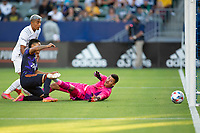 CARSON, CA - JUNE 19: Raúl Ruidíaz #9 of the Seattle Sounders FC scores a goal past Jonathan Bond #1 GK of the Los Angeles Galaxy during a game between Seattle Sounders FC and Los Angeles Galaxy at Dignity Health Sports Park on June 19, 2021 in Carson, California.