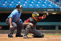 Catcher Bryan Arendt (16) of Holly Springs HS in Holly Springs, NC playing for the Arizona Diamondbacks scout team frames a pitch as home plate umpire Michael Kelley looks on during the East Coast Pro Showcase at the Hoover Met Complex on August 5, 2020 in Hoover, AL. (Brian Westerholt/Four Seam Images)
