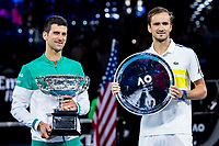 21st February 2021, Melbourne, Victoria, Australia; Novak Djokovic of Serbia and Daniil Medvedev of Russia hold their trophies after the Men's Singles Final of the 2021 Australian Open on February 21 2021, at Melbourne Park in Melbourne, Australia.