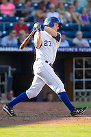 Dan Johnson #23 of the Durham Bulls follows through on his swing against the Charlotte Knights at Durham Bulls Athletic Park on August 28, 2011 in Durham, North Carolina.   (Brian Westerholt / Four Seam Images)