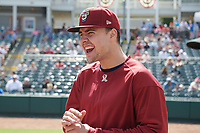 Frisco RoughRiders Brock Burke (23) laughs during the lineup exchange before a Texas League game against the Springfield Cardinals on May 5, 2019 at Dr Pepper Ballpark in Frisco, Texas.  (Mike Augustin/Four Seam Images)