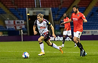 Bolton Wanderers' Lloyd Isgrove breaks away from Salford City's Jason Lowe (right) <br /> <br /> Photographer Andrew Kearns/CameraSport<br /> <br /> The EFL Sky Bet League Two - Bolton Wanderers v Salford City - Friday 13th November 2020 - University of Bolton Stadium - Bolton<br /> <br /> World Copyright © 2020 CameraSport. All rights reserved. 43 Linden Ave. Countesthorpe. Leicester. England. LE8 5PG - Tel: +44 (0) 116 277 4147 - admin@camerasport.com - www.camerasport.com