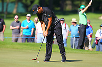 Byeong Hun An sinks his putt on the 5th green during the BMW PGA Golf Championship at Wentworth Golf Course, Wentworth Drive, Virginia Water, England on 26 May 2017. Photo by Steve McCarthy/PRiME Media Images.