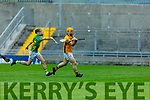 Abbeydorney keeper Nigel Roche clears his defence despite pressure from Michael Kelliher from Lixnaw in the Senior Hurling Championship quarter final.