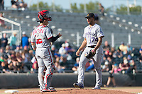 Salt River Rafters relief pitcher Jesus Tinoco (74), of the Colorado Rockies organization, meets with catcher Tres Barrera (12) during a pitching change in the Arizona Fall League Championship game against the Peoria Javelinas at Scottsdale Stadium on November 17, 2018 in Scottsdale, Arizona. Peoria defeated Salt River 3-2 in extra innings. (Zachary Lucy/Four Seam Images)