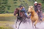 Kodiak Island, cowgirls race across the Pasagshak River,  Alaska.(Malisa Levenson and Rochelle Wood)