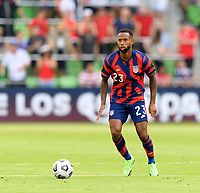 AUSTIN, TX - JULY 29: Kellyn Acosta #23 of the United States looks to pass the ball during a game between Qatar and USMNT at Q2 Stadium on July 29, 2021 in Austin, Texas.