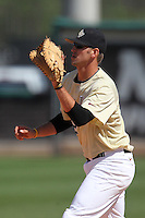 UCF Knights first baseman D.J. Hicks #42 gets ready for a throw during a game against the Siena Saints at the UCF Baseball Complex on March 4, 2012 in Orlando, Florida.  Central Florida defeated Siena 15-2.  (Mike Janes/Four Seam Images)