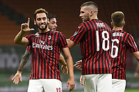 Hakan Calhanoglu of AC Milan celebrates with Ante Rebic after scoring a goal during the Serie A football match between AC Milan and Bologna FC at stadio Giuseppe Meazza in Milano ( Italy ), July 18th, 2020. Play resumes behind closed doors following the outbreak of the coronavirus disease. <br /> Photo Image Sport / Insidefoto
